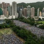 ?Huge crowds march peacefully in Hong Kong