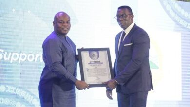 Photo of Commissioner of Insurance conferred with GJA honorary membership status